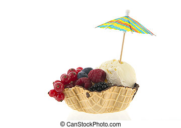 Cup vanilla ice with fruit and parasol