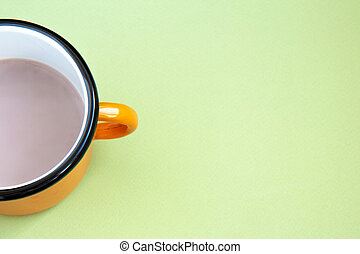 Cup with cocoa on an green background
