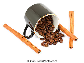 Cup with coffee beans and cinnamon sticks