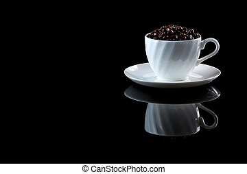 Cup with coffee beans on a black reflective background