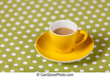 Cup with coffee on a table.