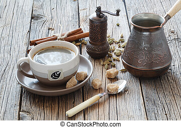 cup with coffee on wood table