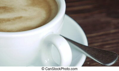 Cup with coffee, saucer and teaspoon - White cup with...