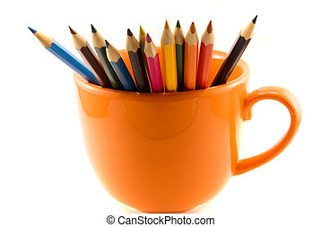 cup with colored pencils isolated on white