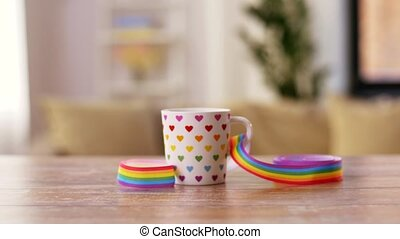 cup with gay or lgbt pride awareness ribbon - homosexual and...