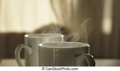 Cup with hot beverage