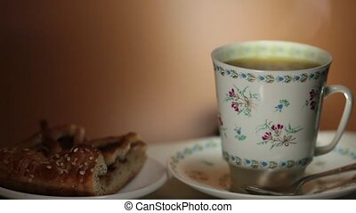 cup with hot tea and steam on background macro shot