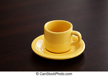 cup with saucer on a wooden table