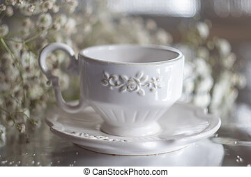 Cup with tea on the table