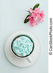 Cupcake and cherry blossoms - Pink buttercream cupcake and ...