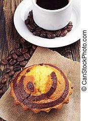 Cupcake and coffee closeup