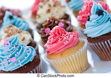 Assortment of brightly colored cupcakes