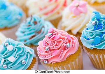 Assortment of pastel colored cupcakes