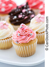 Cupcake assortment - Assortment of pink and white cupcakes