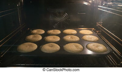 Cupcake baking in oven. Time lapse of cooking muffins