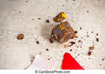 Cupcake Crumbs On Flooring - Cupcake and crumbs on flooring