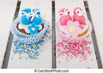 Cupcake for a baby girl and boy - Pink cupcake with baby...
