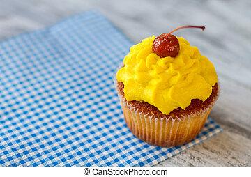 Cupcake on a napkin.