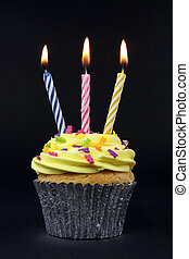 cupcake on black with 3 candles