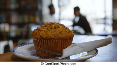 Cupcake on plate in cafe 4k - Close-up of delicious looking ...