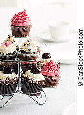 Array of chocolate cupcakes on a stand
