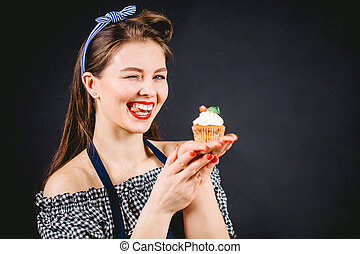 Cupcake temptation on diet. Woman holding sweet delicious cupcake.