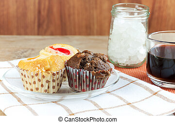 Cupcake various flavors in wood tray on wood table. coffee...