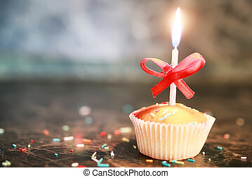 cupcake with a candle holiday - little delicious cupcake...