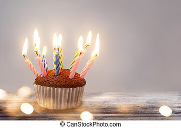 cupcake with birthday party on wooden background