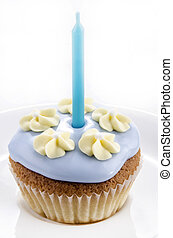 cupcake with blue icing and flower