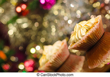 cupcake with christmas tree in background
