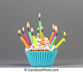 Cupcake with colorful candles