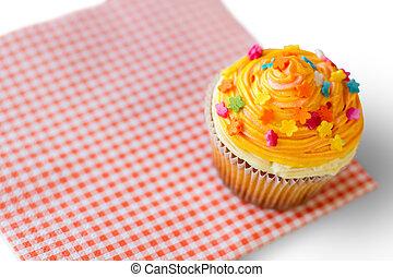 Cupcake with orange icing.