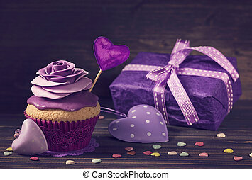 Cupcake with rose and a present