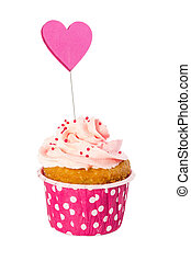 Cupcake with whipped cream in pink paper form with white peas