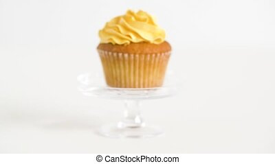 cupcake with yellow frosting on glass stand - food, pastry...