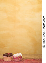 Cupcakes #1 - Cupcakes on pink and brown table cloth in ...