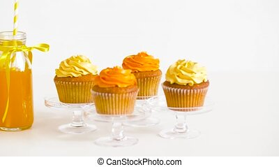 cupcakes and lemonade or juice in glass bottles - birthday...