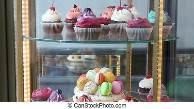 Cupcakes and Macarons in a shop window in the confectionery...