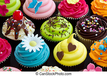 Assortment of brightly decorated cupcakes