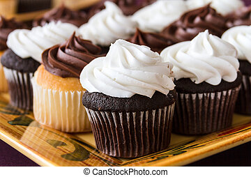 Cupcakes - Chocolate and vanilla cupcakes on decorated...