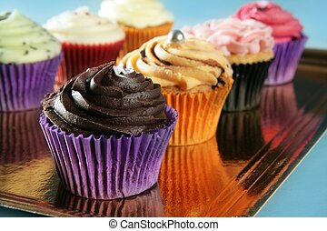 Cupcakes colorful cream muffin arrangement in golden mirror ...