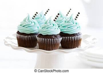 Cupcakes decorated with chocolate straws