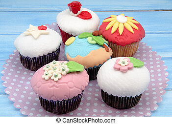 Cupcakes decorated with fondant served on a tray