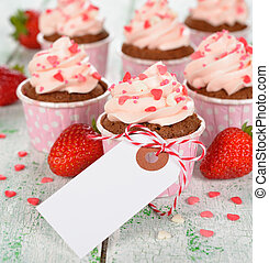 cupcakes decorated with pink cream