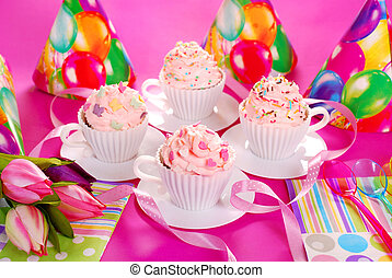 cupcakes in tea cup shape molds for birthday party