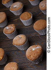 Cupcakes on wooden table still life
