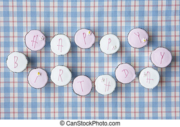Cupcakes spell out happy birthday