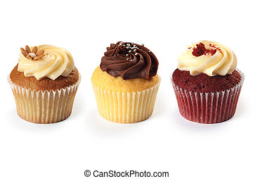 Cupcakes - Photo of three different flavored cupcakes on...