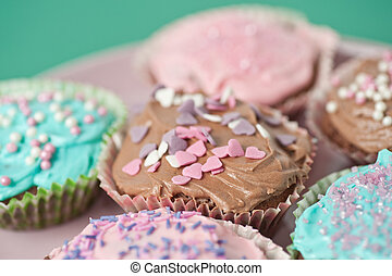 Cupcakes - Homemade cupcakes with frosting on a pastell...